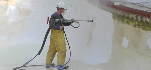 Water Blasting Removing Failed Plaster